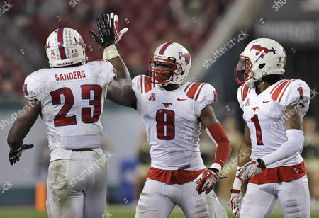Jay Scott, Stephon Sanders, Chris Parks SMU defensive back Jay Scott (8) celebrates with teammates Stephon Sanders (23) and Chris Parks (1) after intercepting a pass by South Florida quarterback Mike White during the fourth quarter of an NCAA college football game, in Tampa, Fla. SMU won the game 16-6