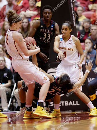 Nikki Moody, Ivey Slaughter, Hallie Christofferson, Natasha Howard Florida State's Ivey Slaughter (23) falls down after a foul by Iowa State's Hallie Christofferson (5), with Iowa State's Nikki Moody (4) and Florida State's Natasha Howard (33) looking, in the second half of a first-round game in the NCAA women's college basketball tournament in Ames, Iowa