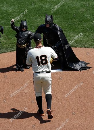 Matt Cain Miles Scott, dressed as Batkid, left, gestures next to Batman on the pitchers mound with San Francisco Giants pitcher Matt Cain (18) after throwing the ceremonial first pitch before an opening day baseball game between the Giants and the Arizona Diamondbacks in San Francisco, . On Nov. 15, 2013, Scott, a Northern California boy with leukemia, fought villains and rescued a damsel in distress as a caped crusader through The Greater Bay Area Make-A-Wish Foundation