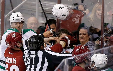 Derek Morris, Antoine Roussel, Alex Chiasson, Keith Yandle, Colton Sceviour, Jay Sharrers Dallas Stars' Antoine Roussel, middle, loses his helmet and gets a finger in his ear from Phoenix Coyotes' Derek Morris (53) as linesman Jay Sharrers (57) tries to break up the melee while Stars' Alex Chiasson, far left, and Colton Sceviour (22) and Coyotes' Keith Yandle (3) all look on during the third period of an NHL hockey game, in Glendale, Ariz. The Coyotes defeated the Stars 2-1