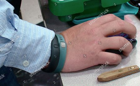 Tim Davis This photo from video taken shows the wrist of Tim Davis wearing his FitBit, green, and Nike FuelBand, black, devices he uses to track his physical activity and habits, in New Brighton, Pa. Davis uses several apps and three wearable devices to track his physical activity, vitals and calorie intake. When Davis tipped the scales at 318 pounds two years ago, he bought a Fitbit gadget to track his physical activity and the Lose It! app on his phone to track calories. He bought a Wi-Fi-enabled scale that published his daily weight on his Twitter feed and turned to other apps to track his pulse, blood pressure, daily moods and medications. At one point, Davis said he was using 15 different apps and gadgets, which he said helped him drop 64 pounds by that following year