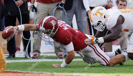 AJ McCarron, Corey Miller Alabama quarterback AJ McCarron (10) dives for the end zone as Tennessee defensive lineman Corey Miller (80) defends during the first half of an NCAA college football game in Tuscaloosa, Ala., . McCarron was short of the goal on the play