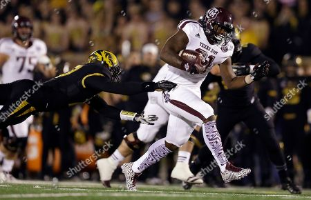Matt White, Tra Carson Texas A&M running back Tra Carson, right, slips past Missouri safety Matt White on his way to a 29-yard touchdown run during the first quarter of an NCAA college football game, in Columbia, Mo