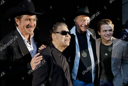 Kix Brooks, Ronnie Milsap, Bobby Bare, Hunter Hayes Ronnie Milsap, second from left, poses with Kix Brooks, left, Bobby Bare, second from right, and Hunter Hayes, right, after Milsap was introduced as one of three new inductees into the Country Music Hall of Fame, in Nashville, Tenn