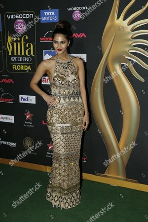 Vaani Kapoor poses for photographers as she walks the green carpet for 15th annual International Indian Film Awards, in Tampa, Fla