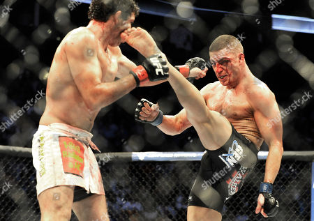 Gilbert Melendez, Diego Sanchez Diego Sanchez, right, delivers a kick to Gilbert Melendez in a UFC lightweight bout in Houston, . Menendez won on a unanimous decision