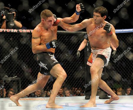 Gilbert Melendez, Diego Sanchez Gilbert Melendez, right, and Diego Sanchez fight in the second round of a UFC lightweight bout in Houston, . Menendez won in a unanimous decision