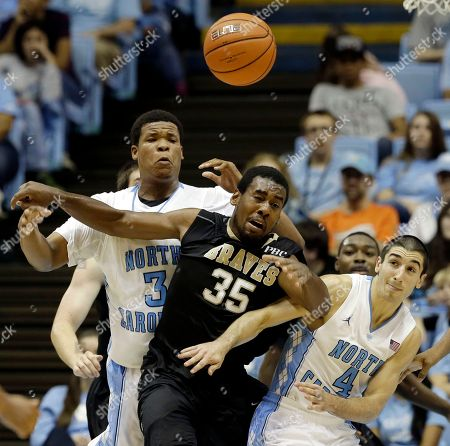 Luke Davis, Kennedy Meeks, Brandon Winford North Carolina's Kennedy Meeks (3) and Luke Davis (4) struggle for a rebound against UNC Pembroke's Brandon Winford (35) during the second half of an exhibition NCAA college basketball game in Chapel Hill, N.C., . North Carolina won 82-63