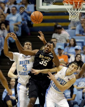 Luke Davis, Kennedy Meeks, Brandon Winford North Carolina's Kennedy Meeks (3) and Luke Davis, right, struggle for a rebound against UNC Pembroke's Brandon Winford (35) during the second half of an exhibition NCAA college basketball game in Chapel Hill, N.C., . North Carolina won 82-63
