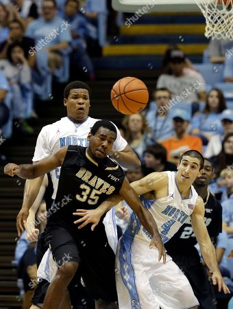 Luke Davis, Kennedy Meeks, Brandon Winford North Carolina's Kennedy Meeks, rear, and Luke Davis (4)struggle for a rebound against UNC Pembroke's Brandon Winford (35) during the second half of an exhibition NCAA college basketball game in Chapel Hill, N.C., . North Carolina won 82-63