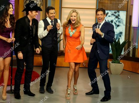 "Lara Spencer, Eugenio Derbez, Johnny Lozado, Ana Patricia Gonzalez, El Dasa Lara Spencer, second from right, of the ABC network's ""Good Morning America,"" show dances with Mexican actor Eugenio Derbez, left, and Johnny Lozado, right, a host on the Univision network morning show, ""Despierta America"" (""Wake Up America"") television show, during a joint live show between between the two programs, in Doral, Fla. Ana Patricia Gonzalez and singer El Dasa look on at left"