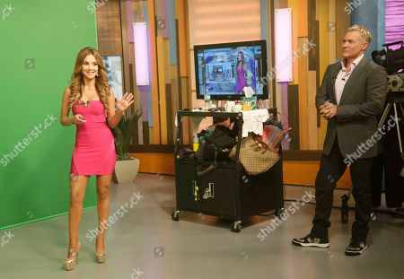 "Sam Champion, Ximena Cordoba Sam Champion, right, of the ABC network's ""Good Morning America,"" show watches Ximena Cordoba as she does the weather in front of a green screen on the Univision network morning show, ""Despierta America"" (""Wake Up America,"") during a joint live broadcast between the two programs, in Doral, Fla"