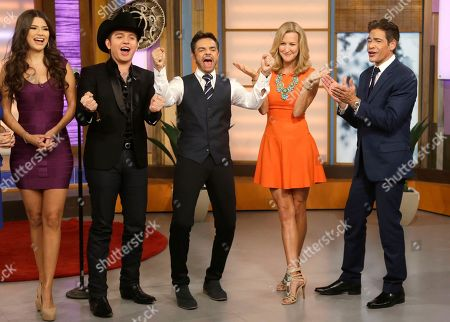 "Lara Spencer, Eugenio Derbez, Johnny Lozado, El Dasa, Ana Patricia Gonzalez Lara Spencer, second from right, of the ABC network's ""Good Morning America,"" is shown with Johnny Lozado, right, a host on the Univision network morning show, ""Despierta America"" (""Wake Up America"") television show, Mexican actor Eugenio Derbez, center, singer El Dasa, second from left, and Ana Patricia Gonzalez, left, during a joint live show between between the two programs, in Doral, Fla. In a joint venture, Univision and ABC launch Monday, Fusion, the first English-language cable network custom-made for young Hispanics"