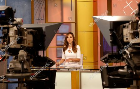 """Stock Photo of Satcha Pretto Satcha Pretto reads the news on the Univision network morning show, """"Despierta America"""" (""""Wake Up America,"""") during a joint live broadcast with """"Good Morning America,"""" in Doral, Fla"""