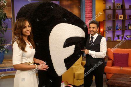 "Eugenio Derbez, Satcha Pretto Mexican actor Eugenio Derbez, right, and Satcha Pretto, left, pose with the new Fusion network mascot on the Univision network morning show, ""Despierta America"" (""Wake Up America,"") in Doral, Fla"
