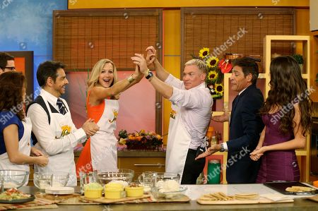"""Sam Champion, Eugenio Derbez, Lara Spencer, Johnny Lozado, Ana Patricia Gonzalez, Alessandra Rosaldo Lara Spencer, third from left, and Sam Champion, third from right, both of the ABC network's """"Good Morning America,"""" show dance during a cooking segment with Alessandra Rosaldo, left, Mexican actor Eugenio Derbez, second from left, Johnny Lozado, second from right, and Ana Patricia Gonzalez, right, on the Univision network morning show, """"Despierta America"""" (""""Wake Up America,"""") during a joint live broadcast between the two programs, in Doral, Fla"""