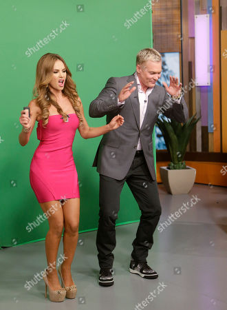 "Sam Champion, Ximena Cordoba Sam Champion, right, of the ABC network's ""Good Morning America,"" show dances with Ximena Cordoba as she does the weather on the Univision network morning show, ""Despierta America"" (""Wake Up America,"") during a joint live broadcast between the two programs, in Doral, Fla. In a joint venture, Univision and ABC launch Monday, Fusion, the first English-language cable network custom-made for young Hispanics"