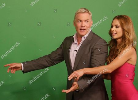 "Sam Champion, Ximena Cordoba Sam Champion, left, of the ABC network's ""Good Morning America,"" show helps Ximena Cordoba as she does the weather in front of a green screen on the Univision network morning show, ""Despierta America"" (""Wake Up America,"") during a joint live broadcast between the two programs, in Doral, Fla"