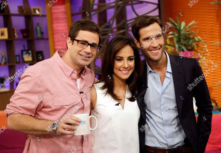 """Stock Photo of Pedro Andrade, Mariana Atencio, Yannis Pappas Three of the new hosts from the Fusion network, from left, Yannis Pappas, Mariana Atencio and Pedro Andrade pose for a photo on the set of the Univision network morning show, """"Despierta America"""" (""""Wake Up America,"""") in Doral, Fla. In a joint venture, Univision and ABC launch Monday, Fusion, the first English-language cable network custom-made for young Hispanics"""