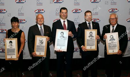 Cindy Curley, Peter Karmanos Jr., Bill Guerin, Doug Weight, and Ron Mason From left, Cindy Curley, Peter Karmanos Jr., Bill Guerin, Doug Weight, and Ron Mason stand with their plaques before being inducted into the United States Hockey Hall of Fame in Detroit