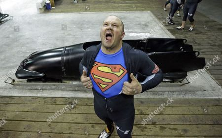 Steve Holcomb Steve Holcomb displays his Superman shirt as he poses for a photograph after the United States four-man bobsled team trials, in Park City, Utah. Steve Holcomb's crew came in first place