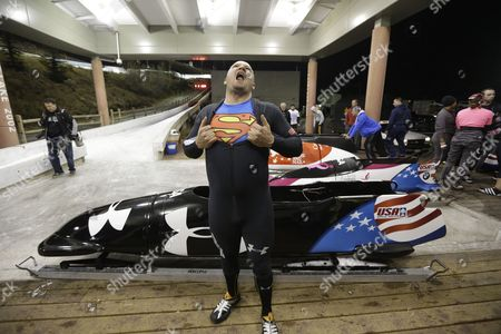 Steve Holcomb Steve Holcomb displays his Superman shirt as he poses for a photograph in front of his sled after the United States four-man bobsled team trials, in Park City, Utah. Holcomb and his crew came in first place
