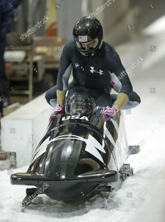 Stock Photo of Steve Holcomb, Curt Tomasevicz From front to back, Steve Holcomb and Curt Tomasevicz come to a stop after racing in the United States four-man bobsled team trials, in Park City, Utah. Holcomb nad his crew came in first place