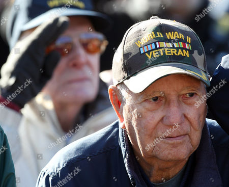 World War II veteran David Burrows listens during a Veterans Day ceremony at the New Hampshire State Veterans Cemetery, in Boscawen, N.H. Across the nation, Americans are commemorating Veterans Day with parades, wreath-laying ceremonies and monument dedications