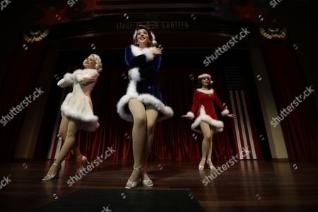 "Courtney Boe, Mandi Ridgell, Christina Perez, Victory Belles Courtney Boe, left, Mandi Ridgell, center, and Christina Perez, members of the singing group ""The Victory Belles,"" modeled after the WWII era group The Andrew Sisters, rehearse for their upcoming Christmas show, ""A Swingin' Christmas,"" at the Stage Door Canteen at the National WWII Museum in New Orleans. The sexy, classy, glamorous 20-somethings perform year-round at the National World War II Museum in New Orleans in the tradition of the wartime entertainers of Hollywood's golden age"
