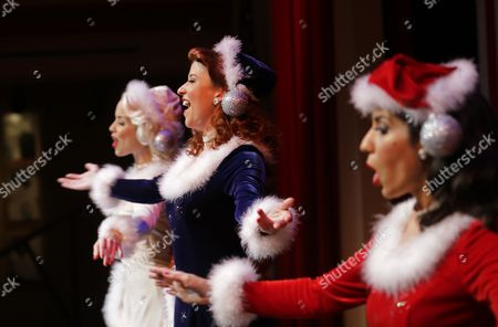 "Stock Picture of Courtney Boe, Mandi Ridgell, Christina Perez, Victory Belles Courtney Boe, left, Mandi Ridgell, center, and Christina Perez, members of the singing group ""The Victory Belles,"" modeled after the WWII era group The Andrew Sisters, rehearse for their upcoming Christmas show, ""A Swingin' Christmas,"" at the Stage Door Canteen at the National WWII Museum in New Orleans. The sexy, classy, glamorous 20-somethings perform year-round at the National World War II Museum in New Orleans in the tradition of the wartime entertainers of Hollywood's golden age"