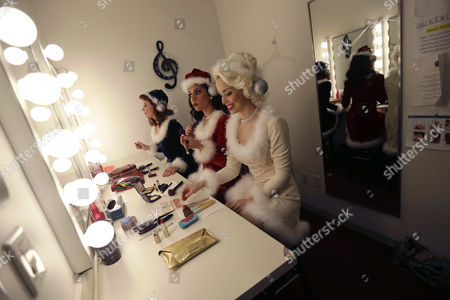 "Courtney Boe, Mandi Ridgell, Christina Perez, Victory Belles Mandi Ridgell, left, Christina Perez, center, and Courtney Boe, members of the singing group ""The Victory Belles,"" modeled after the WWII era group The Andrew Sisters, get ready in their dressing room before rehearsing for their upcoming Christmas show, ""A Swingin' Christmas,"" at the Stage Door Canteen at the National WWII Museum in New Orleans. The sexy, classy, glamorous 20-somethings perform year-round at the National World War II Museum in New Orleans in the tradition of the wartime entertainers of Hollywood's golden age"
