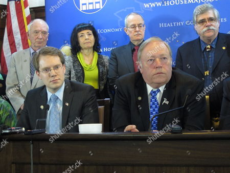 Stock Picture of Members of the Republican-led House majority address reporters following a vote on a bill to raise Alaska's minimum wage, in Juneau, Alaska. Shown, seated from left, are House Majority Leader Lance Pruitt and House Speaker Mike Chenault. Standing, from left, are Reps. Steve Thompson, Shelley Hughes, Mike Hawker and Kurt Olson