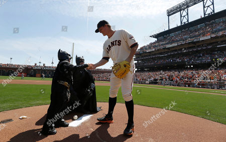 Matt Cain San Francisco Giants pitcher Matt Cain, right, shakes hands with Miles Scott, dressed as Batkid, on the pitchers mound after Scott threw the ceremonial first pitch before an opening day baseball game between the Giants and the Arizona Diamondbacks in San Francisco, . On Nov. 15, 2013, Scott, a Northern California boy with leukemia, fought villains and rescued a damsel in distress as a caped crusader through The Greater Bay Area Make-A-Wish Foundation
