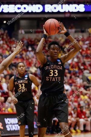 Stock Image of Natasha Howard, Lauren Coleman Florida State's Natasha Howard (33) is about to pass the ball with teammate Florida State's Lauren Coleman, left, in the second half of a first-round game against Iowa State in the NCAA women's college basketball tournament in Ames, Iowa