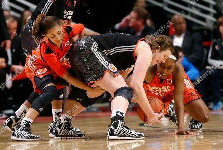 Bianca Cuevas, Chatrice White, Jatarie White McDonald's West All-American Chatrice White, center, battles McDonald's East All American Jatarie White, right, and Gabby Williams, left, for a loose ball during the second half of the McDonald's All-American girls' basketball game, in Chicago. The West won 80-78