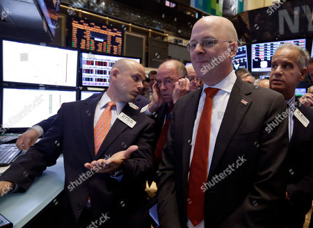 Michael Carroll Brixmor Property Group CEO Michael Carroll, foreground right, watches as his company's stock is priced during its IPO on the floor of the New York Stock Exchange . Brixmor owns and operates the nation's largest wholly owned portfolio of grocery-anchored community and neighborhood shopping centers