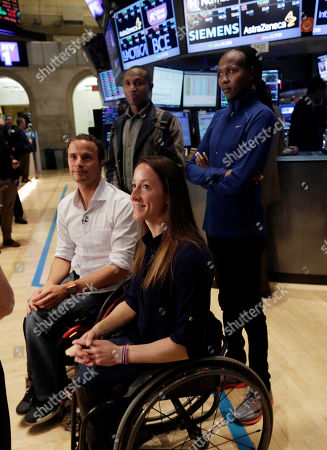 Stock Picture of Geoffrey Mutai, Priscah Jeptoo, Tatyana McFadden, Marcel Hug New York City marathon winners Geoffrey Mutai, bacground left, and Priscah Jeptoo, background right, of Kenya, with wheelchair winners Tatyana McFadden, from Baltimore, Md., and Marcel Hug, of Switzerland, visit the trading floor after they rang the New York Stock Exchange opening bell