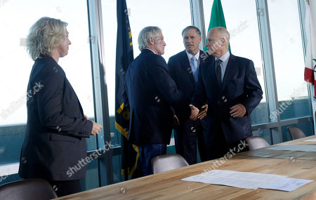 Stock Image of Jerry Brown, John Kitzhaber, Jay Inslee, Mary Polak From left, Mary Polak, environment minister of British Columbia, representing British Columbia premier Christy Clark, looks on as Oregon Gov. John Kitzhaber, Washington Gov. Jay Inslee and California Gov. Jerry Brown shake hands after signing an agreement to collectively combat climate change, in San Francisco. The group will work together to coordinate efforts with the hope of stimulating a clean-energy economy in a region with a combined gross domestic product of $2.8 trillion
