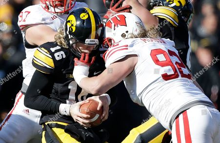 C.J. Beathard, Pat Muldoon Iowa quarterback C.J. Beathard (16) is sacked by Wisconsin defensive end Pat Muldoon during the second half of an NCAA college football game, in Iowa City, Iowa. Wisconsin won 28-9