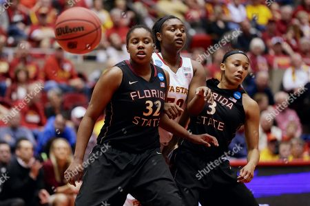 Stock Image of Lauren Coleman, Emiah Bingley, Fallon Ellis Florida State's Lauren Coleman (32), Emiah Bingley (3) and Iowa State's Fallon Ellis (32) jockey for position during a free throw in the first half of a first-round game in the NCAA women's college basketball tournament in Ames, Iowa