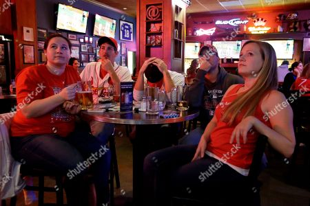 St. Louis Cardinals fans, from left to right, Ericka Lanter, Doug Allen, Matt Toeges, Bryan Cataldi and Emily Lanter watch Game 6 of baseball's World Series between the Cardinals and the Boston Red Sox on televisions at a bar, in St. Louis. The Red Sox won the game 6-1 and won the series