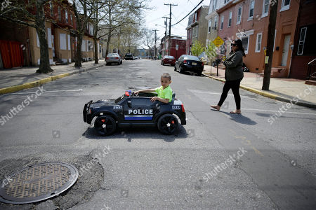 """Jayvon Accetti, Melanie Andujar Graph, Jayvon Accetti, 5, drives his toy police car as his mother, Melanie Andujar, walks along behind in Camden, N.J. Andujar says her son Jayvon constantly says he wants to be a Camden police officer. Camden disbanded its police department on May 1 and handed patrols over to the new Camden County-run department that promised more officers for the same cost. The new department says crime dropped sharply in every category except arson in the first three months of this year, when the new department had enough officers for intense patrols in every neighborhood. """"To me, violence will always be around and so will the drugs,"""" said Melanie Andujar. She's still shaken by a shooting on her block a few weeks ago. """"Has it calmed down? Yes. I don't think it will ever stop"""