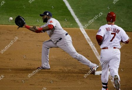 Boston Red Sox first baseman David Ortiz catches the throw from third baseman Jacoby Ellsbury on a ground out by St. Louis Cardinals left fielder Matt Holliday (7) during the first inning of Game 4 of baseball's World Series, in St. Louis
