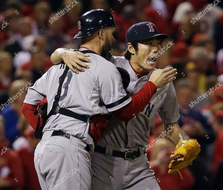Boston Red Sox relief pitcher Koji Uehara hugs catcher David Ross after getting St. Louis Cardinals' Matt Holliday to fly out and end Game 5 of baseball's World Series, in St. Louis. The Red Sox won 3-1 to take a 3-2 lead in the series