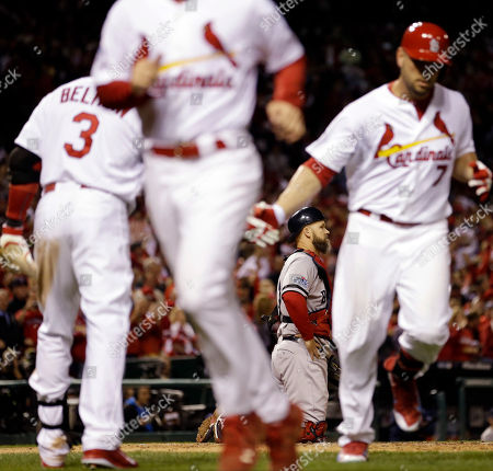 Boston Red Sox catcher David Ross looks ahead as St. Louis Cardinals' Matt Holliday (7) celebrates his home run during the fourth inning of Game 5 of baseball's World Series, in St. Louis