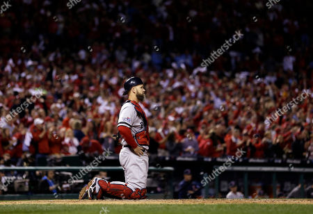 Boston Red Sox catcher David Ross looks ahead after St. Louis Cardinals' Matt Holliday (7) celebrates his home run during the fourth inning of Game 5 of baseball's World Series, in St. Louis