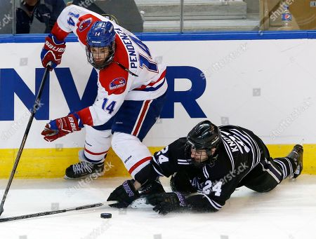Brett Knowles, Joseph Pendenza Minnesota State, Mankato's Brett Knowles (24) dives to control the puck against UMass Lowell's Joseph Pendenza (14) in the third period of an NCAA Northeast Regional hockey game in Worcester, Mass., . UMass Lowell won 2-1