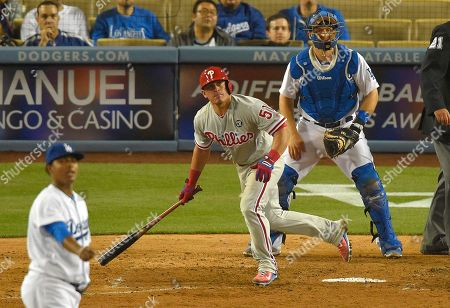 Carlos Ruiz,Tim Federowicz, Jose Dominguez Philadelphia Phillies' Carlos Ruiz, center, hits a two-run home run as Los Angeles Dodgers relief pitcher Jose Dominguez, left, looks on along with catcher Tim Federowicz looks on during the ninth inning of a baseball game, in Los Angeles