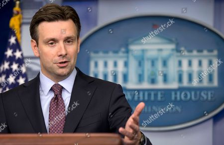 "Josh Earnest White House deputy press secretary Josh Earnest speaks during the daily news briefing at the White House in Washington, . Among the topics Earnest discussed were Secretary of State John Kerry and the Middle East Peace talks, the creation of a ""Cuban Twitter"", and the death of Associated Press photographer Anja Niedringhaus who was shot and killed by an Afghan policeman in Khost, Afghanistan. Associated Press reporter Kathy Gannon was also wounded twice in the same attack and is receiving medical attention"