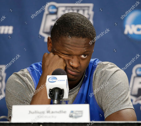 Julius Randle Kentucky forward Julius Randle answers a question during a news conference for the NCAA Final Four tournament college basketball championship game, in Arlington, Texas. Kentucky plays Connecticut in the championship game on Monday, April 7. 2014